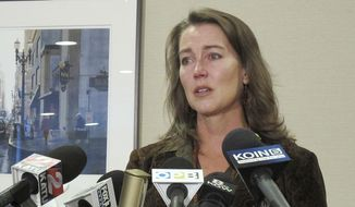 "Cylvia Hayes, fiancee of Oregon Gov. John Kitzhaber, speaks at a news conference in Portland, Ore. on Thursday, Oct. 9, 2014. Hayes has admitted that she violated the law when she married an immigrant seeking to retain residency in the United States. She said she was ""associating with the wrong people"" while struggling to put herself through college and regrets her actions. (AP Photo/Gosia Wozniacka)"