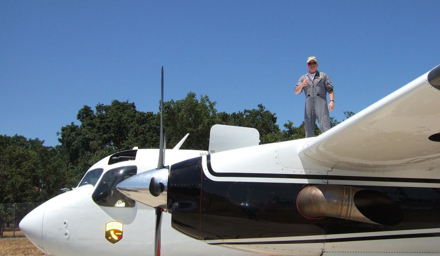 "This undated photo provided by DynCorp International shows pilot Geoffrey ""Craig"" Hunt who was killed Tuesday, Oct. 7, 2014,  while fighting the Dog Rock Fire in Yosemite National Park. Hunt, 62, a 13-year veteran pilot of Dyncorp International, was flying a S-2T air tanker, similar to the plane in the photo, under contract with the state, when his plane hit a canyon wall while fighting the blaze that has caused the closure of the major western entrance into the heart of the park. CalFire has temporarily grounded it's fleet of S-2T's for inspection.(AP Photo/DynCorp International)"