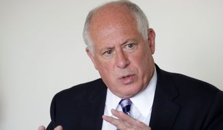 In 2012, Illinois Democratic Gov. Pat Quinn signed into law a bill aimed at addressing concerns about private organization employees in the Teachers Retirement System, especially those who had not been teachers previously but used a state law to claim past employment service toward their pensions. (Associated Press)