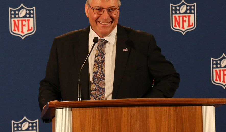 Terry Pegula talks to the media at the NFL owners meetings in New York, Wednesday, Oct. 8, 2014. Admitting it was a dream come true, Terry Pegula and wife Kim were unanimously approved by NFL owners as new owners of the Buffalo Bills. (AP Photo/The Buffalo News, James P. McCoy)