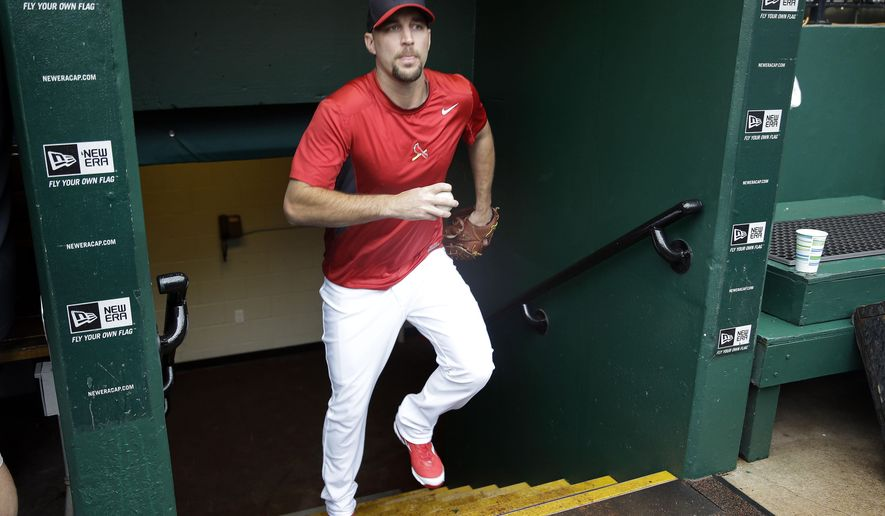 St. Louis Cardinals starting pitcher Adam Wainwright heads up stairs from the clubhouse to the dugout Thursday, Oct. 9, 2014, in St. Louis. Wainwright is scheduled to be the Game 1 starter when the Cardinals play the San Francisco Giants in baseball's National League Championship Series on Saturday in St. Louis. (AP Photo/Jeff Roberson)