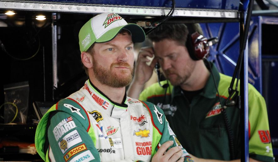 Dale Earnhardt Jr. waits in the garage during practice for Saturday's NASCAR Bank of America Sprint Cup series auto race in Concord, N.C., Thursday, Oct. 9, 2014. (AP Photo/Terry Renna) ** FILE **