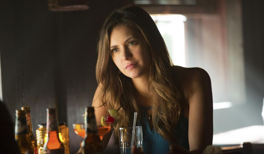 "In this undated image released by The CW, Nina Dobrev portrays Elena Gilbert in a scene from ""The Vampire Diaries,"" airing Thursdays at 8 p.m. ET. (AP Photo/The CW, Bob Mahoney)"