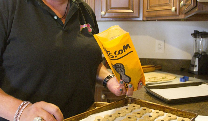 Paula TenBrink prepares dog biscuits, Thursday, Oct. 2, 2014. TenBrink runs Paw-la's Pantry from her Oceola Township home. (AP Photo/Livingston County Daily Press & Argus, Gillis Benedict)