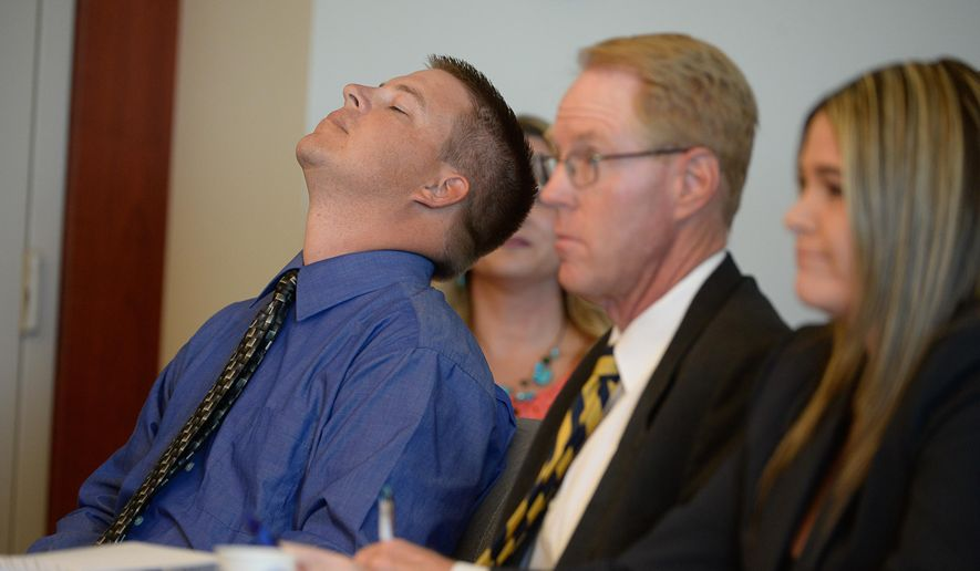 Former West Valley City police officer Shaun Cowley tilts his head back as hears the ruling by Judge L.A. Dever that he is dismissing a manslaughter charge filed against Crowley, Thursday, Oct. 9, 2014 in Salt Lake City. Cowley is charged with second-degree felony manslaughter in connection with the Nov. 2, 2012 fatal shooting of 21-year-old Danielle Willard. At right are defense attorneys Paul Cassell and Lindsay Jarvis. (AP Photo/The Salt Lake Tribune, Francisco Kjolseth, Pool)