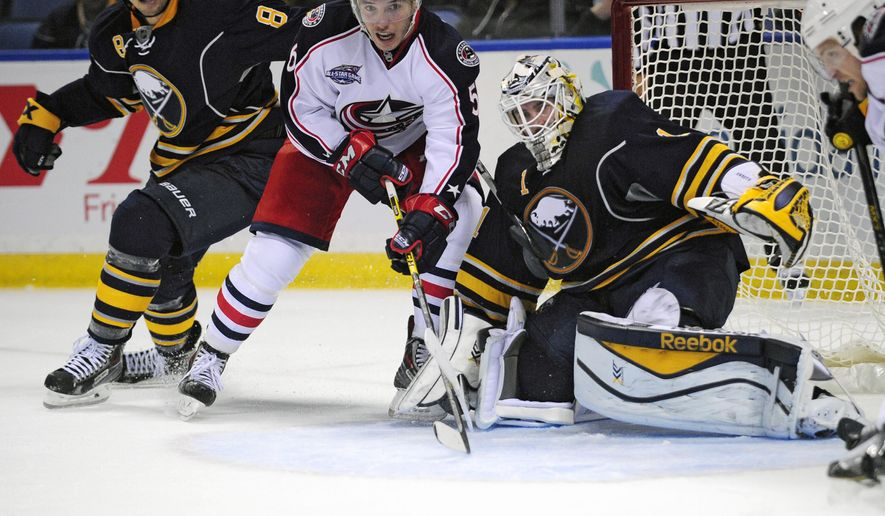 Buffalo Sabres center Cody McCormick (8) and goaltender Jhonas Enroth (1) of Sweden, watch an incoming shot with Columbus Blue Jackets center Marko Dano (56), of Austria, during the second period of an NHL hockey game season opener, Thursday, Oct., 9, 2014, in Buffalo, N.Y. (AP Photo/Gary Wiepert)