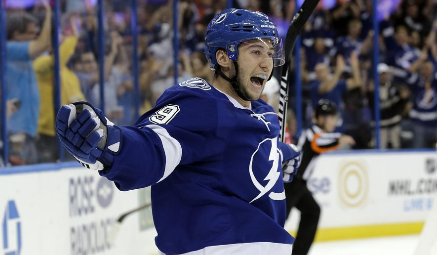 Tampa Bay Lightning center Tyler Johnson (9) celebrates after scoring against the Florida Panthers during the second period of an NHL hockey game Thursday, Oct. 9, 2014, in Tampa, Fla. (AP Photo/Chris O'Meara)