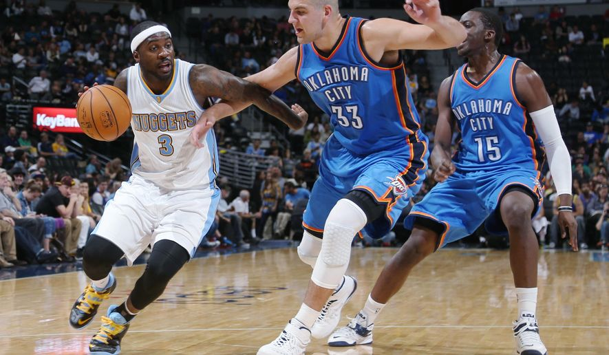 From left, Denver Nuggets guard Ty Lawson works ball inside for shot as Oklahoma City Thunder rookie forward Mitch McGary and guard Reggie Jackson cover in the third quarter of the Nuggets' 114-101 victory in an NBA exhibition basketball game in Denver on Wednesday, Oct. 8, 2014. (AP Photo/David Zalubowski)