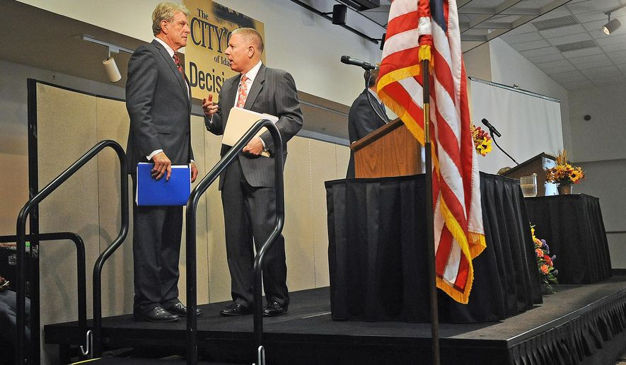 """Republican Incumbent C.L. """"Butch"""" Otter, left, speaks with Democratic Challenger AJ Balukoff for a moment after the gubernatorial debate hosted by the City Club of Idaho Falls at the Idaho State University Bennion Student Union Building Thursday, Oct. 9, 2014. (AP Photo/Idaho Post-Register, Pat Sutphin)"""