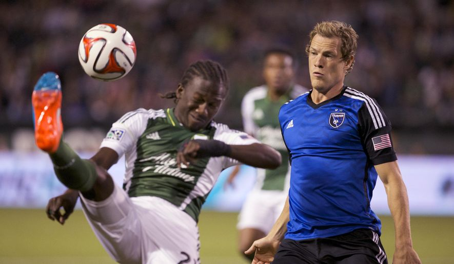 Portland Timbers midfielder Diego Chara (21) sends a first half kick against San Jose Earthquakes defender Ty Harden (2) Wednesday, Oct. 8, 2014, at Providence Park in Portland, Ore.   (AP Photo/The Oregonian, Randy L. Rasmussen)  MAGS OUT; TV OUT; LOCAL TELEVISION OUT; LOCAL INTERNET OUT; THE MERCURY OUT; WILLAMETTE WEEK OUT; PAMPLIN MEDIA GROUP OUT