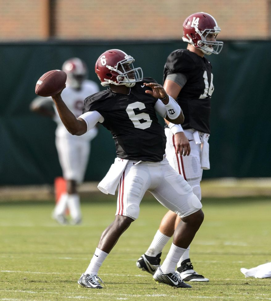 Alabama quarterback Blake Sims (6) works through drills during Alabama football practice, Wednesday, Oct. 8, 2014, at the Thomas-Drew Practice Facility in Tuscaloosa, Ala. Alabama quarterback Jacob Coker (14) is in the background.   (AP Photo/AL.com, Vasha Hunt) MAGS OUT