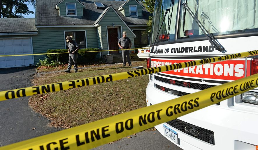 Police remain at the scene where a quadruple homicide was discovered Wedensday on Western Avenue in Guilderland, N.Y., on Thursday, Oct. 9, 2014. Authorities were still attempting to identify the bodies as of late Wednesday night. Police in an Albany suburb have scheduled a news conference Thursday to discuss their investigation. (AP Photo/The Daily Gazette, Patrick Dodson)  TROY, SCHENECTADY; SARATOGA SPRINGS; ALBANY AND AMSTERDAM OUT