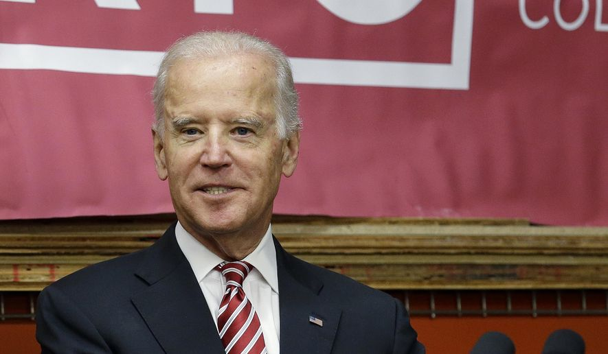 Vice President Joe Biden picks up his notes as he prepares to leave after speaking at Renton Technical College in Renton, Wash., Thursday, Oct. 9, 2014. (AP Photo/Elaine Thompson)