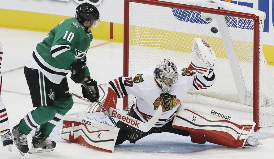 Dallas Stars forward Shawn Horcoff (10) is unable to deflect a shot past Chicago Blackhawks goalie Corey Crawford (50) in the second period of an NHL hockey game, Thursday, Oct. 9, 2014, in Dallas. (AP Photo/Brandon Wade)