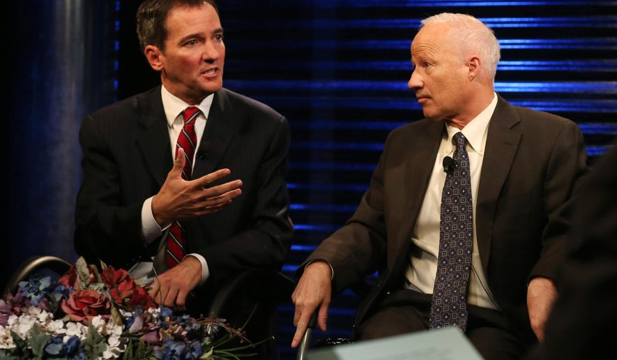 Democratic challenger Andrew Romanoff, left, makes point as his opponent, Republican incumbent Mike Coffman, looks on during taped debate in the race for the seat in Colorado's 6th Congressional District in the studios of Channel 12 in Denver on Thursday, Oct. 9, 2014. Romanoff and Coffman are vying for the seat in the most competitive House race. (AP Photo/David Zalubowski)