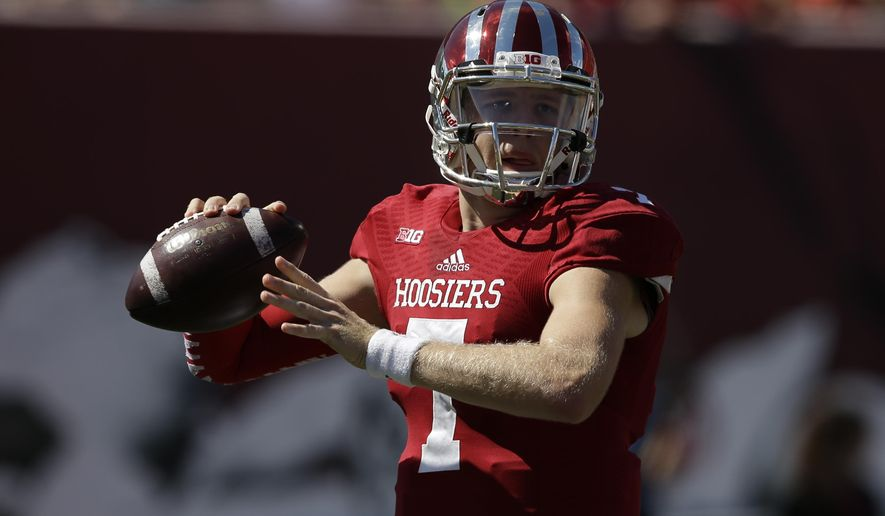 FILE - This Saturday, Sept 27, 2014 file photo shows Indiana quarterback Nate Sudfeld throwing during the first half of an NCAA college football game against Maryland in Bloomington, Ind. Sudfeld has completed 97 of 158 passes for 1,066 yards and five scores. (AP Photo/Darron Cummings, File)