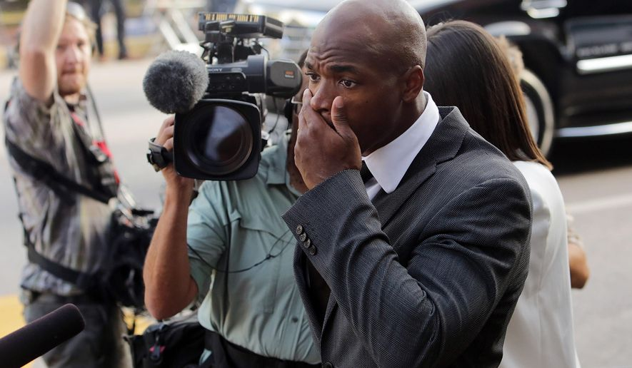 Minnesota Vikings running back Adrian Peterson arrives at court in Conroe, Texas, Wednesday, Oct. 8, 2014. A judge tentatively set a Dec. 1 trial date for Peterson on a charge of felony child abuse for using a wooden switch to discipline his 4-year-old son earlier this year. (AP Photo/Houston Chronicle, Billy Smith II)