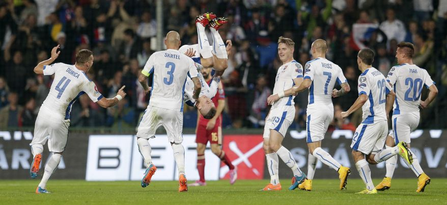 Slovakia's Juraj Kucka, 3rd left, celebrates with teammates after scoring during the Group C Euro 2016 qualifying match between Slovakia and Spain in Zilina, Slovakia, Thursday, Oct. 9, 2014.  (AP Photo/Petr David Josek)
