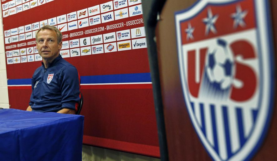 United States soccer head coach Jurgen Klinsmann waits as he is introduced during a press conference in East Hartford, Conn. Thursday, Oct. 9, 2014. The U.S. will host Ecuador in a friendly soccer match on Friday. (AP Photo/Elise Amendola)
