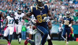 St. Louis Rams' Brian Quick reacts after scoring a touchdown during the first half of an NFL football game against the Philadelphia Eagles, Sunday, Oct. 5, 2014, in Philadelphia. (AP Photo/Matt Rourke)