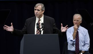 Vice President Joe Biden, right, listens as U.S. Sen. Jeff Merkley speaks during a campaign rally in Portland, Ore., Wednesday, Oct. 8, 2014. Biden is in Portland campaigning for Merkley who is being challenged by Republican Monica Wehby. (AP Photo/Don Ryan)