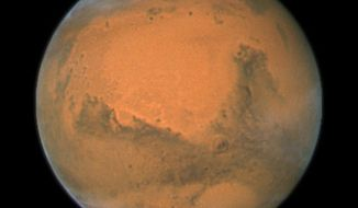This image provided by NASA's Hubble Space Telescope shows a close-up of the red planet Mars. (AP Photo/NASA) **FILE**
