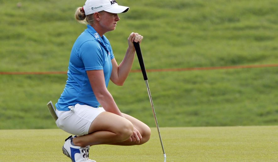 Stacy Lewis of the United States lines up her putt on the first green during the first round of the LPGA Malaysia golf tournament at Kuala Lumpur Golf and Country Club in Kuala Lumpur, Malaysia, Thursday, Oct. 9, 2014. (AP Photo/Lai Seng Sin)