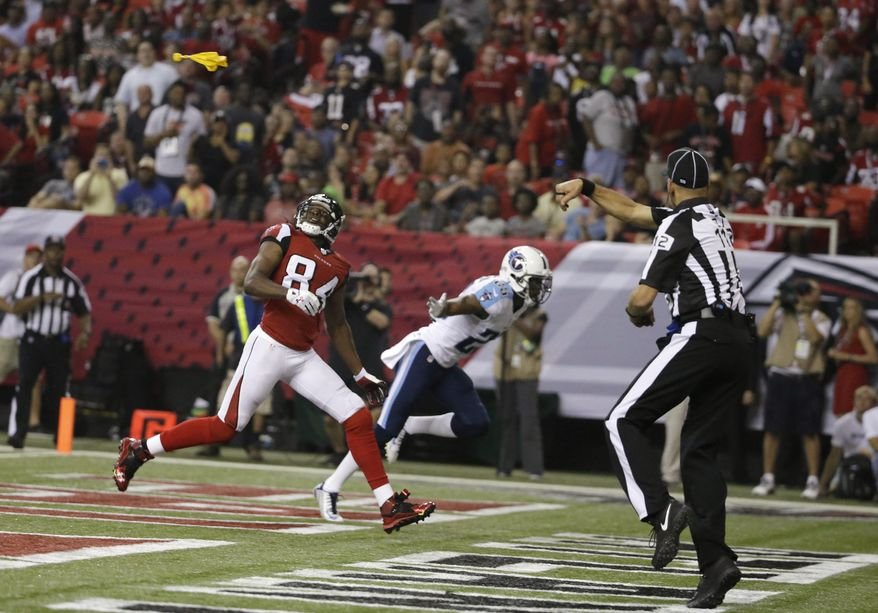 FILE - In this Aug. 23, 2014, file photo, Atlanta Falcons wide receiver Roddy White (84) waits for the ball as back judge Tony Steratore throws a penalty flag against the Tennessee Titans during the first half of an NFL preseason football game in Atlanta. The NFL's emphasis on defensive-backfield penalties has contributed to an average of more than two extra flags every game this season, a 15 percent rise from 2013.  (AP Photo/David Goldman, File)
