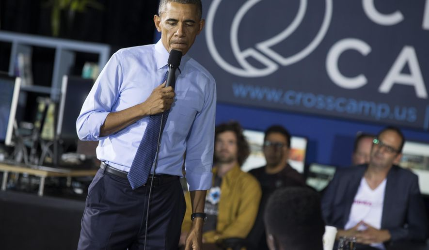 President Barack Obama pauses as he listens to a question during a town hall event at Cross Campus, a collaborative space that brings together freelancers, creative professionals, entrepreneurs and startup teams, on Thursday, Oct. 9, 2014, in Santa Monica, Calif. Obama is traveling in Los Angeles for an overnight trip during which he will discuss the nation's economy and designate a swath of Southern California mountains as a national monument. (AP Photo/Evan Vucci)