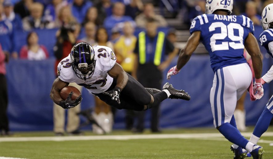 Baltimore Ravens running back Justin Forsett dives into the end zone for a touchdown in front of Indianapolis Colts strong safety Mike Adams during the second half of an NFL football game in Indianapolis, Sunday, Oct. 5, 2014. (AP Photo/Jeff Roberson)