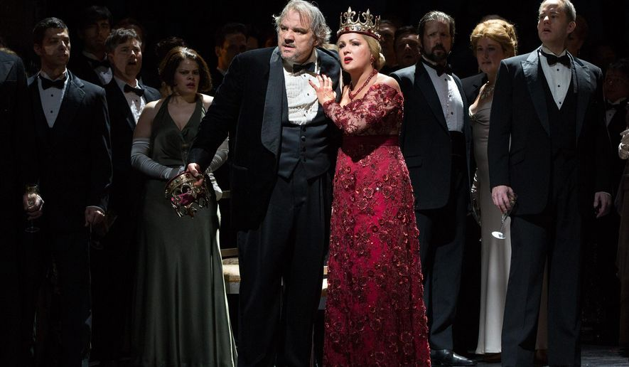 "In this Sept. 20, 2014 photo released by the Metropolitan Opera, Anna Netrebko portrays Lady Macbeth and  Zeljko Lucic portrays the title role in Verdi's ""Macbeth,"" at the Metropolitan Opera in New York. Netrebko has created a sensation at the Metropolitan Opera with her dramatically searing, opulently sung portrayal of Verdi's anti-heroine. (AP Photo/Metropolitan Opera, Marty Sohl)"