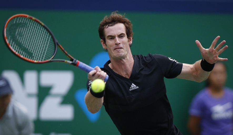 Andy Murray of Britain returns a shot against David Ferrer of Spain during their men's singles third round match at the Shanghai Masters Tennis Tournament in Shanghai, China, Thursday, Oct. 9, 2014. (AP Photo/Vincent Thian)