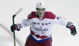 Washington Capitals' Andre Burakovsky celebrates after scoring a goal during the first period of an NHL hockey game against the Montreal Canadiens, Thursday, Oct 9, 2014, in Washington. (AP Photo/Luis M. Alvarez)