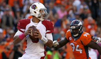 Arizona Cardinals quarterback Logan Thomas looks to pass under pressure from Denver Broncos defensive end DeMarcus Ware (94) during the second half of an NFL football game, Sunday, Oct. 5, 2014, in Denver. (AP Photo/Joe Mahoney)