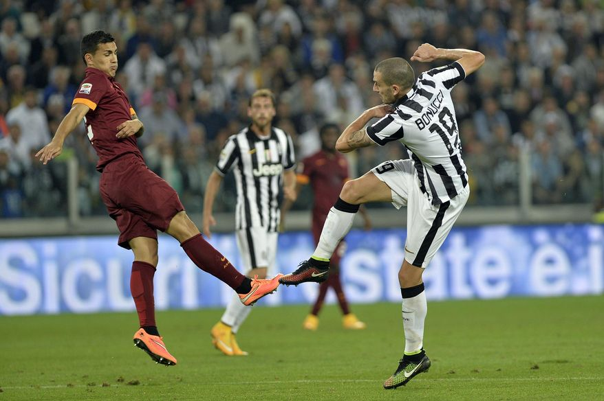 Juventus' Leonardo Bonucci scores during a Serie A soccer match between Juventus and Roma at the Juventus stadium, in Turin, Italy, Sunday, Oct. 5, 2014. Juventus beat Roma 3-2 in a fiery clash to take sole lead of the Serie A on Sunday as the capital side dropped its first points of the season. (AP Photo/Massimo Pinca)