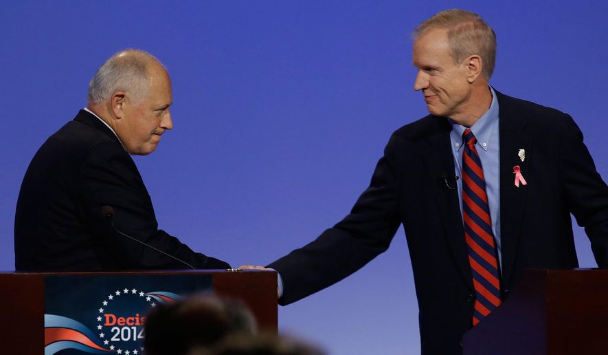 Democratic Illinois Gov. Pat Quinn, left, and Illinois Republican gubernatorial candidate businessman Bruce Rauner right, shake hands after the first televised debate Thursday, Oct.  9, 2014, in Peoria Ill. (AP Photo/Seth Perlman)