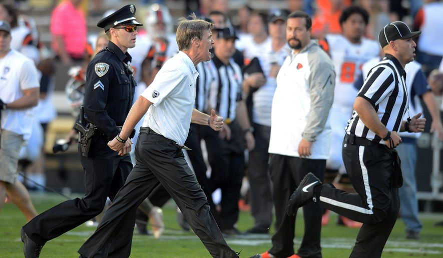 In this Oct. 4, 2014, photo, Colorado head coach Mike MacIntyre yells at an official after a 36-31 loss to Oregon State in an NCAA college football game in Boulder, Colo. The Pac-12 conference has reprimanded and fined MacIntyre $10,000 for conduct toward the officials following the game. (AP Photo/Cliff Grassmick, The Daily Camera) NO SALES