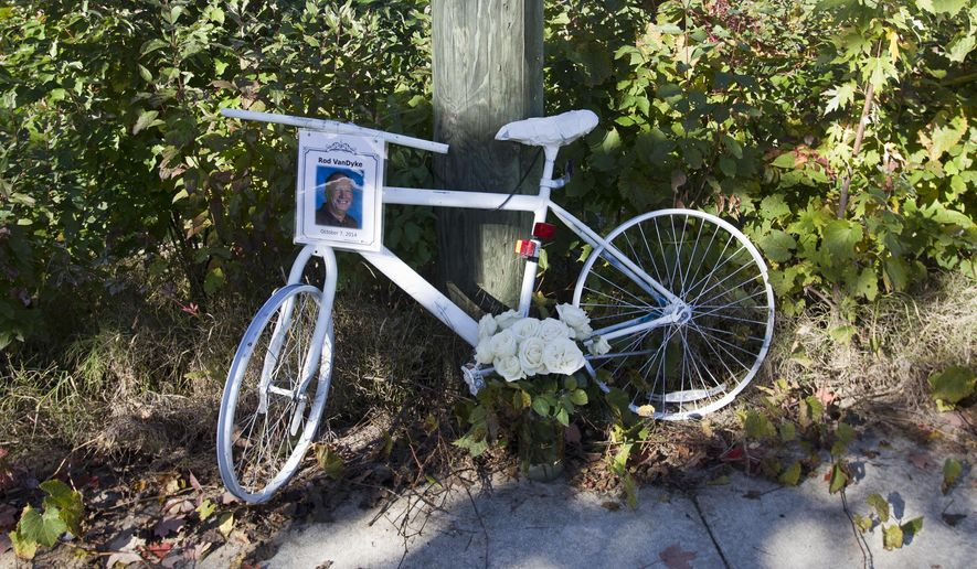 """A """"Ghost Bike"""" memorial to Rod Van Dyke is displayed on 36th, near Jasper, in Georgetown Township, Mich., Thursday, Oct. 9, 2014. Van Dyke, a South Christian High School math teacher and girls varsity golf coach, was struck and killed by a car while riding his bicycle Oct. 7. Ghost Bikes are placed as a tribute to bicyclists who lose their lives in traffic accidents.  (AP Photo/The Grand Rapids Press, Cory Morse) ALL LOCAL TELEVISION OUT; LOCAL TELEVISION INTERNET OUT"""