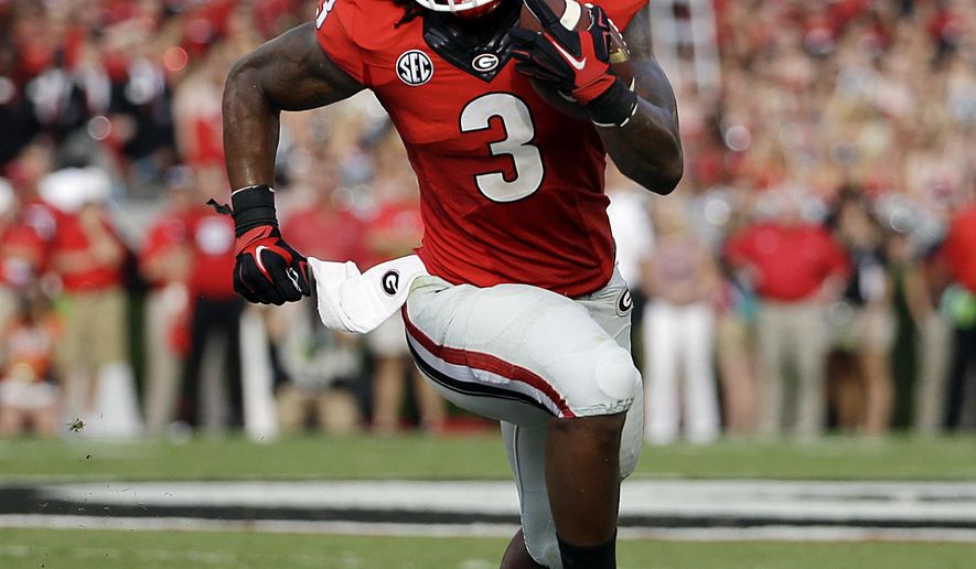 FILE - In this Aug. 30, 2014, file photo, Georgia's Todd Gurley runs the ball in the first half of an NCAA college football game against Clemson in Athens, Ga. Gurley has been suspended indefinitely while the school investigates an alleged violation of NCAA rules, the school announced Thursday, Oct. 9, 2014. (AP Photo/David Goldman, File)