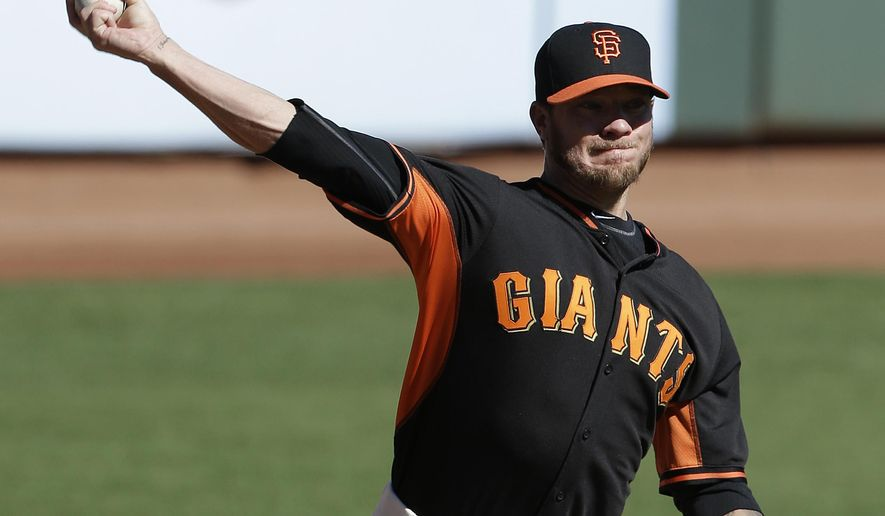 San Francisco Giants pitcher Jake Peavy throws during baseball practice in San Francisco, Wednesday, Oct. 8, 2014. The Giants are to play the St. Louis Cardinals in baseball's NL Championship Series. (AP Photo/Jeff Chiu)