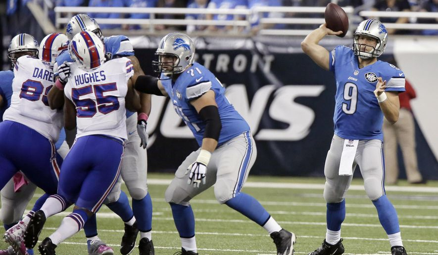 Detroit Lions quarterback Matthew Stafford (9) throws against the Buffalo Bills during the first quarter of an NFL football game Sunday, Oct. 5, 2014, in Detroit. (AP Photo/Duane Burleson)