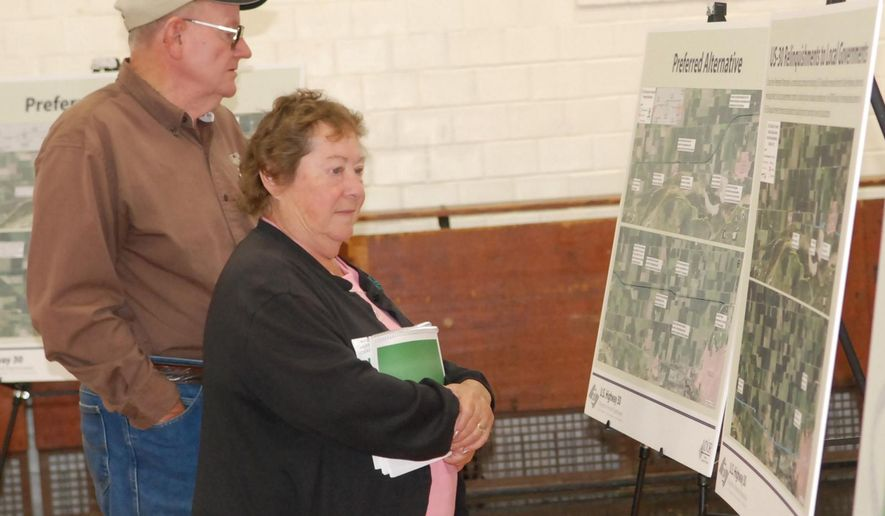 Rich and Millie Tank of rural Fremont, Nebraska, review plans for the U.S. 30 expressway project during an open house at North Bend City Auditorium in North Bend, Neb., Wednesday, Oct. 8, 2014. More than 200 people attended the open house to ask Nebraska road officials questions about the proposed alternative route for the expressway between Schuyler and Fremont. (AP Photo/The Tribune, Chris Zavadil)