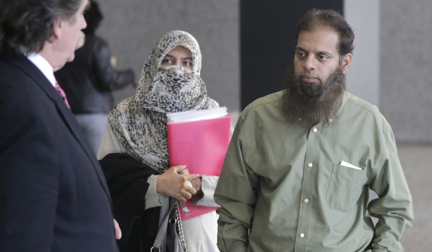 Shafi Khan (right) and Zarine Khan (center), parents of Mohammed Hamzah Khan, meet with the family's attorney, Thomas Dirkin before Mr. Khan's detention hearing in federal court in Chicago Thursday. The 19-year-old suburban man, accused of seeking to travel to Syria to join Islamic State militants, is charged with attempting to provide material support to foreign terrorists. (AP Photo/Charles Rex Arbogast)