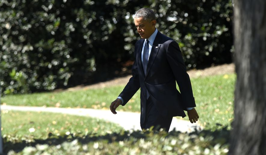 President Barack Obama walks to Marine One on the South Lawn of the White House in Washington, Thursday, Oct. 9, 2014, for a short trip to Andrews Air Force Base, Md., then onto California for three days. (AP Photo/Susan Walsh)