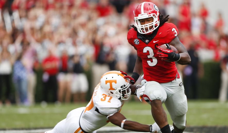 Georgia running back Todd Gurley (3) tries to break free from Tennessee defensive back Brian Randolph (37) during the second half of an NCAA college football game, Saturday, Sept. 27, 2014, in Athens, Ga. Georgia won 35-32. (AP Photo/John Bazemore)