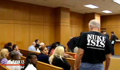 "Pastor Terry Jones, an anti-Islam Florida pastor who was arrested last year on his way to burn 3,000 Korans, showed up in Polk County court Tuesday morning wearing a ""NUKE ISIS"" T-shirt. (FOX 13)"