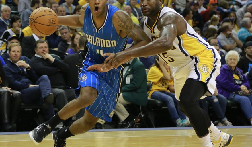 Orlando Magic guard Elfrid Payton, left, drives around Indiana Pacers guard Donald Sloan in the first half of a preseason NBA basketball game in Indianapolis, Friday, Oct. 10, 2014. (AP Photo/R Brent Smith)