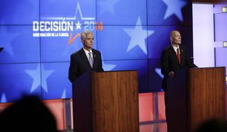 Democrat Charlie Crist, a former Republican governor of Florida, left, and Florida Republican Gov. Rick Scott, right, participate in a gubernatorial debate at the Spanish-language network Telemundo 51, Friday, Oct. 10, 2014, in Miramar, Fla. This is the first of three debates before the November election. (AP Photo/Lynne Sladky)