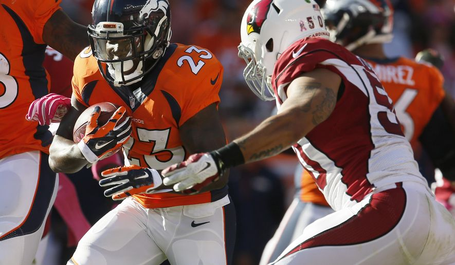 Denver Broncos running back Ronnie Hillman (23) runs against the Arizona Cardinals during the second half of an NFL football game, Sunday, Oct. 5, 2014, in Denver. (AP Photo/Joe Mahoney)