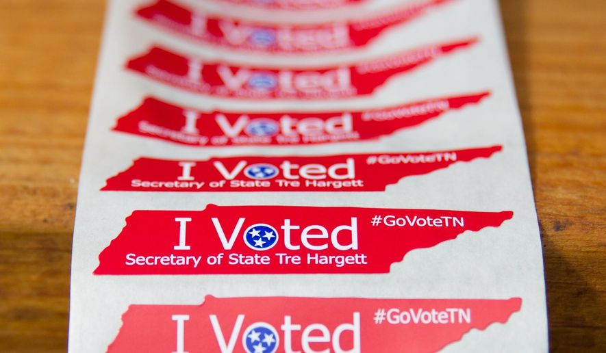 """New """"I Voted"""" stickers featuring the name of prominent Republican Secretary of State Tre Hargett are displayed on Friday, Oct. 10, 2014, in Nashville, Tenn. The new stickers replace generic stickers handed out at polling places in past elections.  (AP Photo/Erik Schelzig)"""
